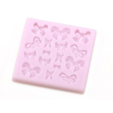 Stampo in silicone fiocchetti piccoli -  in vendita su Sugarmania.it